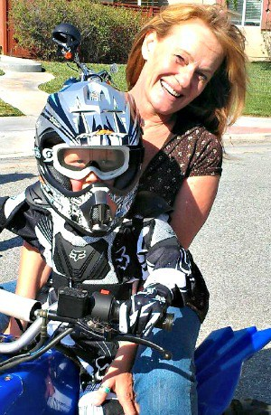 Suzanne Randa, who was killed last May in Southern California in a motorcycle crash while wearing a novelty helmet, with a grandson. (Courtesy of Kelli Meador)